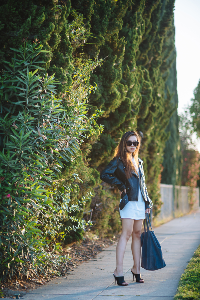 Neon Blush, Acne Studios leather jacket, Urban Outfitters t-shirt dress, Zara mules, blue suede bag, Celine sunglasses